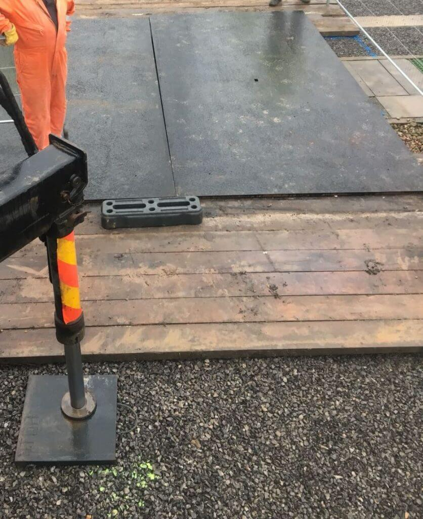 Hardwood timber mat with road plate